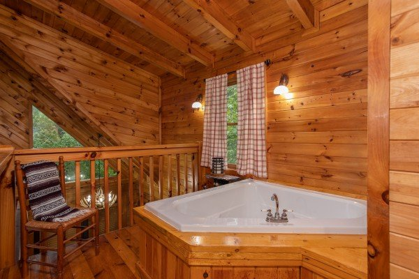 Jacuzzi tub in the loft at Cabin in the Woods, a 1-bedroom cabin rental located in Pigeon Forge
