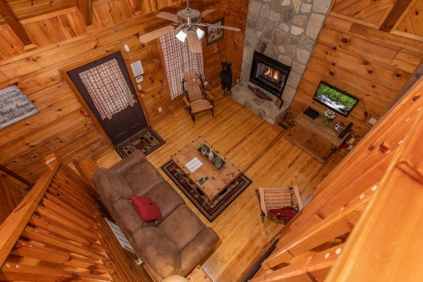 Looking down into the living room from upstairs at Cabin in the Woods, a 1-bedroom cabin rental located in Pigeon Forge