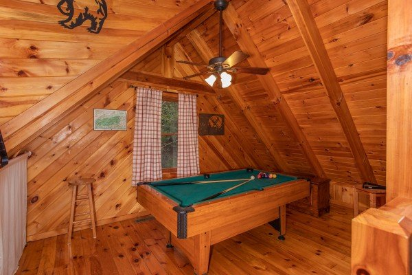 Green felted pool table in a loft at Cabin in the Woods, a 1-bedroom cabin rental located in Pigeon Forge