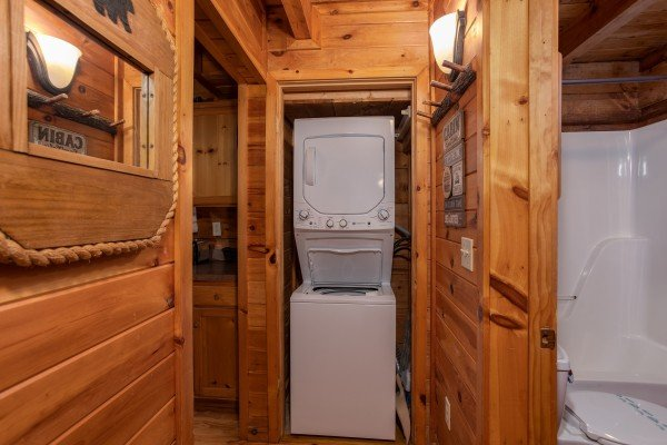 Stacked washer and dryer at Cabin in the Woods, a 1-bedroom cabin rental located in Pigeon Forge