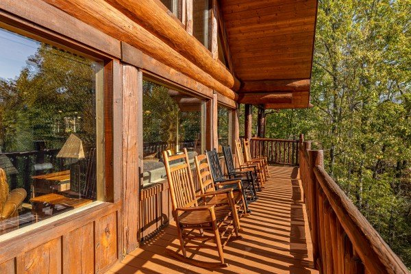 Rocking chairs on an open deck at Grizzly's Den, a 5 bedroom cabin rental located in Gatlinburg