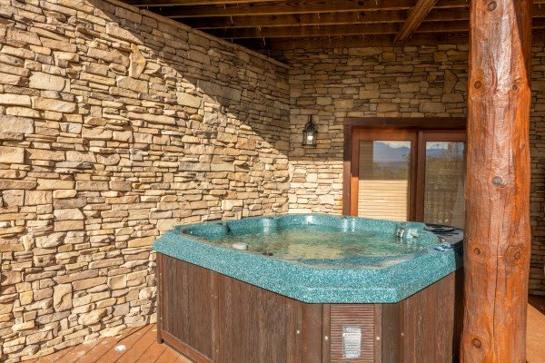 Hot tub on the lower deck at Grizzly's Den, a 5 bedroom cabin rental located in Gatlinburg