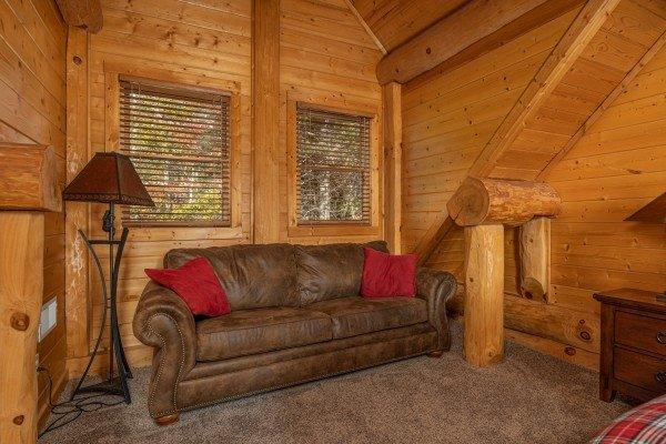 Sofa in a bedroom at Grizzly's Den, a 5 bedroom cabin rental located in Gatlinburg