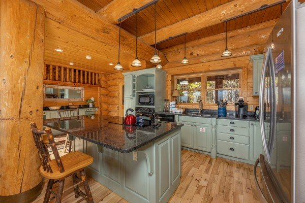 Kitchen island with granite top at Grizzly's Den, a 5 bedroom cabin rental located in Gatlinburg