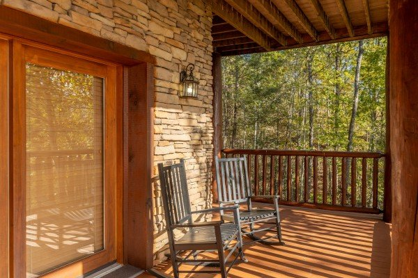 Rocking chairs on a deck at Grizzly's Den, a 5 bedroom cabin rental located in Gatlinburg