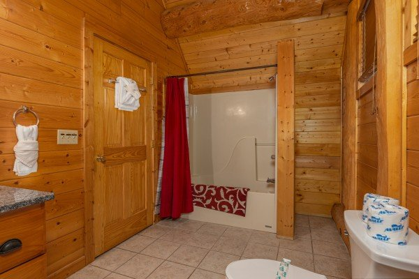 Bathroom with a tub and shower at Grizzly's Den, a 5 bedroom cabin rental located in Gatlinburg