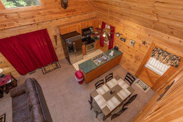 Looking down on the dining space and kitchen at Skyline Retreat, a 2 bedroom cabin rental located in Sevierville