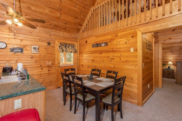 Dining table for six at Skyline Retreat, a 2 bedroom cabin rental located in Sevierville