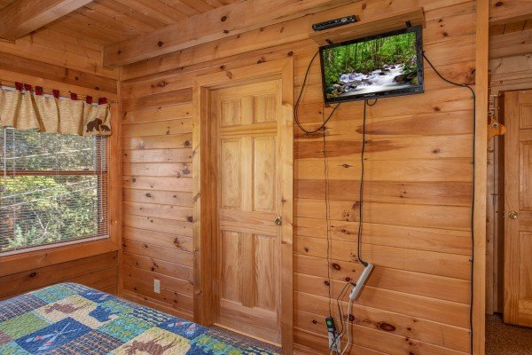 Wall mounted TV in a bedroom at Skyline Retreat, a 2 bedroom cabin rental located in Sevierville