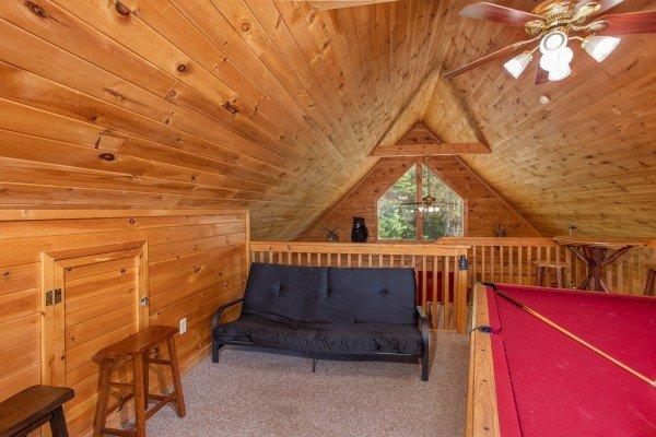 Futon in the game loft at Skyline Retreat, a 2 bedroom cabin rental located in Sevierville