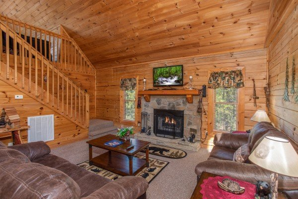 Fireplace and TV in the living room at Skyline Retreat, a 2 bedroom cabin rental located in Sevierville