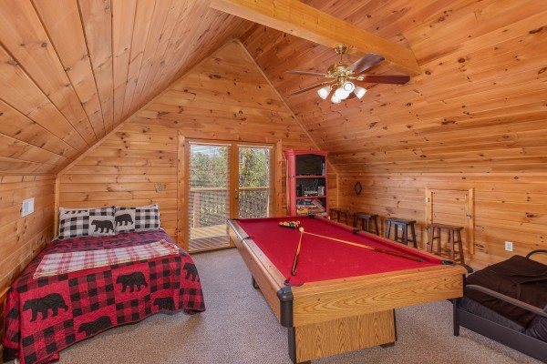 Loft bedroom with pool table at Skyline Retreat, a 2 bedroom cabin rental located in Sevierville