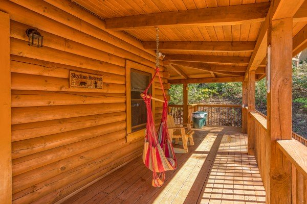 Hammock and rocking chair on a covered deck at Skyline Retreat, a 2 bedroom cabin rental located in Sevierville