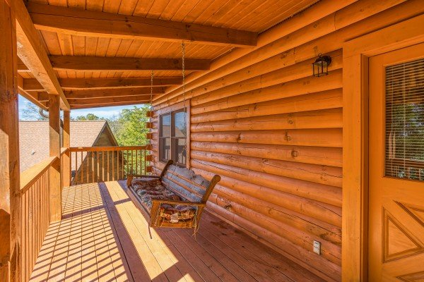 Swing on a covered porch at Skyline Retreat, a 2 bedroom cabin rental located in Sevierville