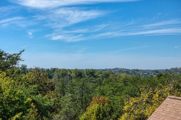 Looking out on the treetops at Skyline Retreat, a 2 bedroom cabin rental located in Sevierville