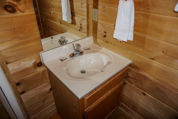 Bathroom vanity at Moonlight in the Boondocks, a 2 bedroom cabin rental located in Gatlinburg