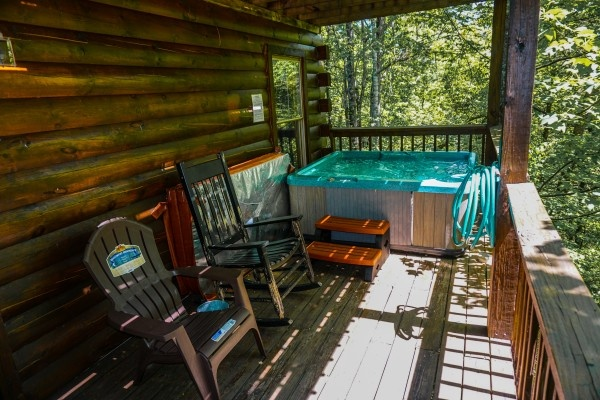 Seating on the deck by the hot tub at Moonlight in the Boondocks, a 2 bedroom cabin rental located in Gatlinburg