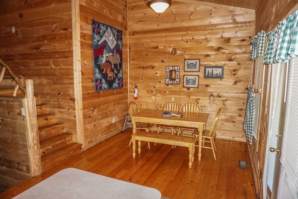 Dining area at Moonlight in the Boondocks, a 2 bedroom cabin rental located in Gatlinburg