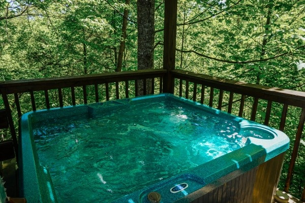 Hot tub at Moonlight in the Boondocks, a 2 bedroom cabin rental located in Gatlinburg