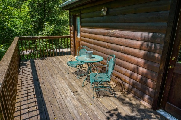 Patio furniture on deck at Moonlight in the Boondocks, a 2 bedroom cabin rental located in Gatlinburg