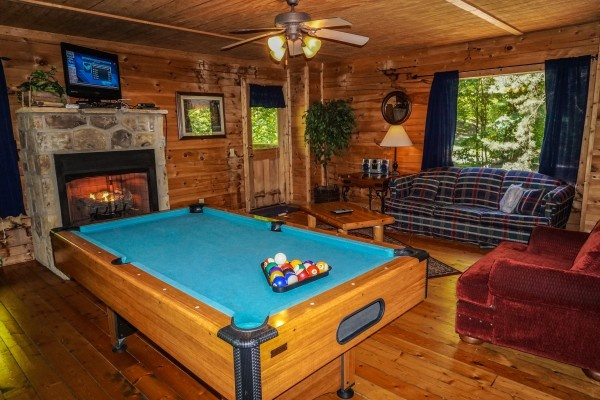 Pool table in the living room at Moonlight in the Boondocks, a 2 bedroom cabin rental located in Gatlinburg