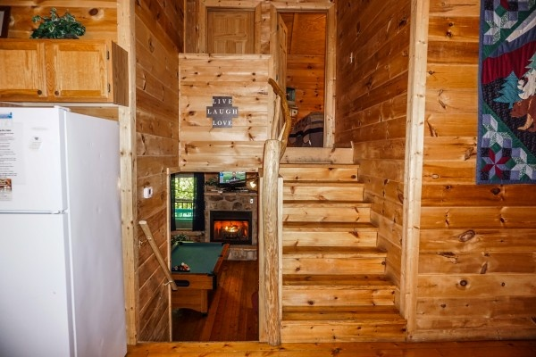 Steps up to bedrooms and down to living room from the main floor kitchen at Moonlight in the Boondocks, a 2 bedroom cabin rental located in Gatlinburg