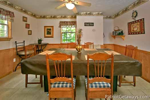 Dining table for six at A Hidden Treasure, a 2 bedroom cabin rental located in Pigeon Forge