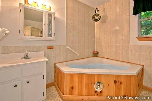 Jacuzzi tub in bathroom at A Hidden Treasure, a 2 bedroom cabin rental located in Pigeon Forge