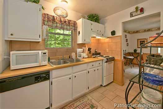 Kitchen at A Hidden Treasure, a 2 bedroom cabin rental located in Pigeon Forge