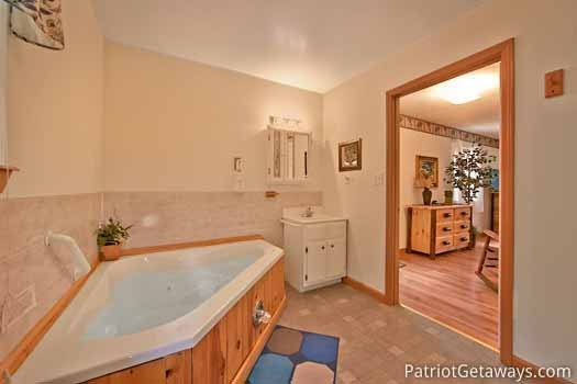Jacuzzi tub in master bathroom at A Hidden Treasure, a 2 bedroom cabin rental located in Pigeon Forge