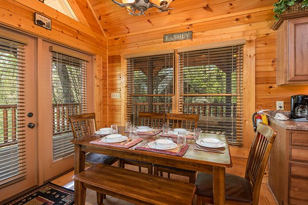 Dining table for six at Honey Bear Lodge, a 3 bedroom cabin rental located in Gatlinburg