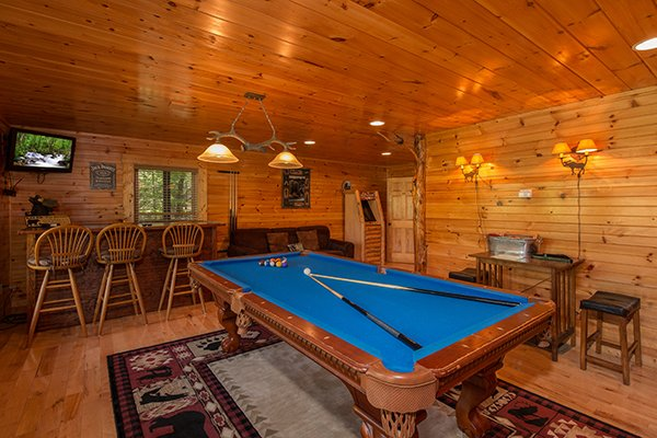 Convertible pool table in the game room at Honey Bear Lodge, a 3 bedroom cabin rental located in Gatlinburg