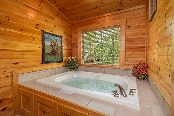 Jacuzzi tub off a bedroom at Honey Bear Lodge, a 3 bedroom cabin rental located in Gatlinburg