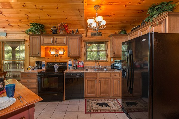 Kitchen with black appliances at Honey Bear Lodge, a 3 bedroom cabin rental located in Gatlinburg