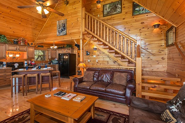 Main floor with living room, dining space, and kitchen at Honey Bear Lodge, a 3 bedroom cabin rental located in Gatlinburg