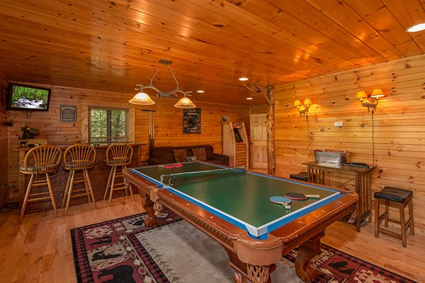 Convertible ping pong table in the game room at Honey Bear Lodge, a 3 bedroom cabin rental located in Gatlinburg