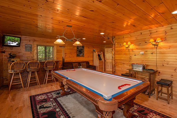 Convertible table top hockey game in the game room at Honey Bear Lodge, a 3 bedroom cabin rental located in Gatlinburg