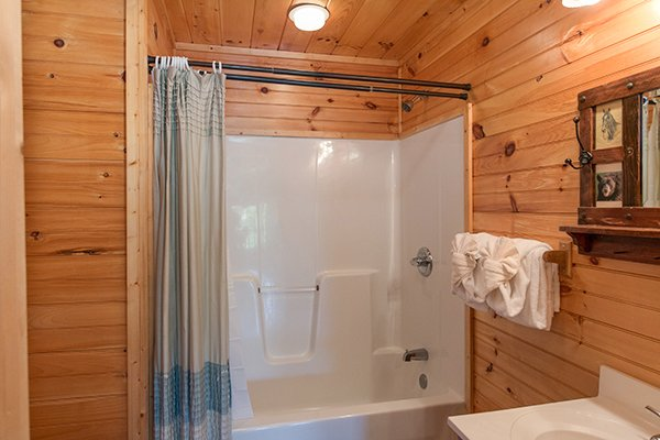 Bathroom with a tub and shower at Honey Bear Lodge, a 3 bedroom cabin rental located in Gatlinburg