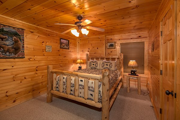 Bedroom with a queen log bed and two end tables at Honey Bear Lodge, a 3 bedroom cabin rental located in Gatlinburg