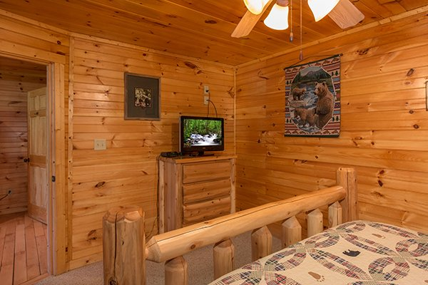 Bedroom with a TV and chest of drawers at Honey Bear Lodge, a 3 bedroom cabin rental located in Gatlinburg