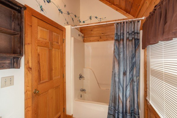 bathroom with tub and shower at another day in bearadise a 2 bedroom cabin rental located in pigeon forge