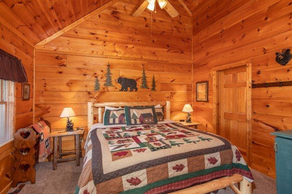 bedroom with vaulted ceiling at another day in bearadise a 2 bedroom cabin rental located in pigeon forge