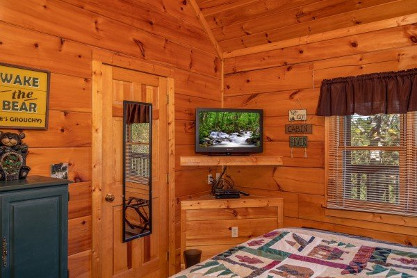 bedroom with flat screen television at another day in bearadise a 2 bedroom cabin rental located in pigeon forge