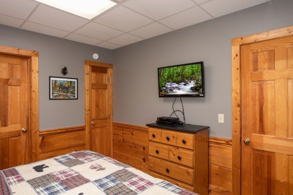 bedroom with storage and wall mounted television at another day in bearadise a 2 bedroom cabin rental located in pigeon forge