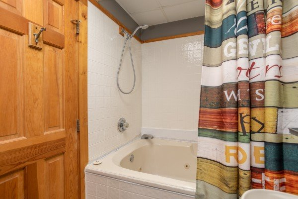 jacuzzi with showerhead at another day in bearadise a 2 bedroom cabin rental located in pigeon forge