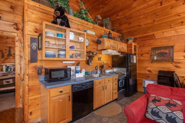 kitchen with black appliances at another day in bearadise a 2 bedroom cabin rental located in pigeon forge
