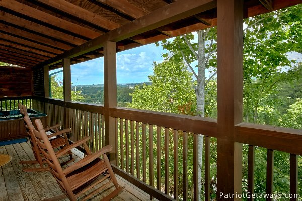 rockers on the deck at another day in bearadise a 2 bedroom cabin rental located in pigeon forge