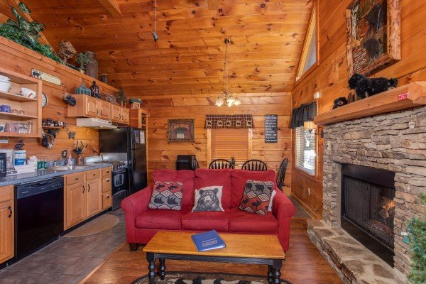 studio style living room with fireplace at another day in bearadise a 2 bedroom cabin rental located in pigeon forge