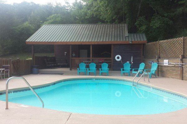 enjoy the resort swimming pool when you stay at another day in bearadise a 2 bedroom cabin rental located in pigeon forge