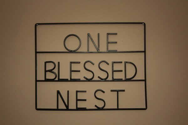 Custom sign at One Blessed Nest, a 3 bedroom cabin rental located in Pigeon Forge